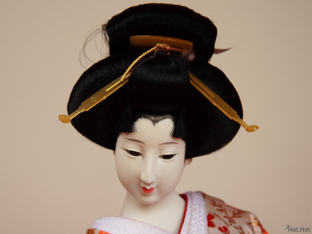 close up of a geisha doll