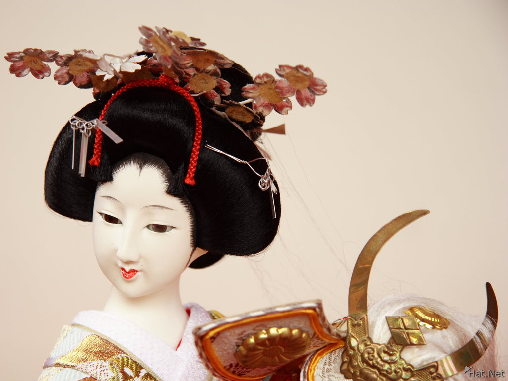 view--kada - geisha doll with headdress