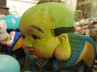 giant green head doll