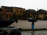 dancing in rain Hoi An, South East Asia, Vietnam, Asia