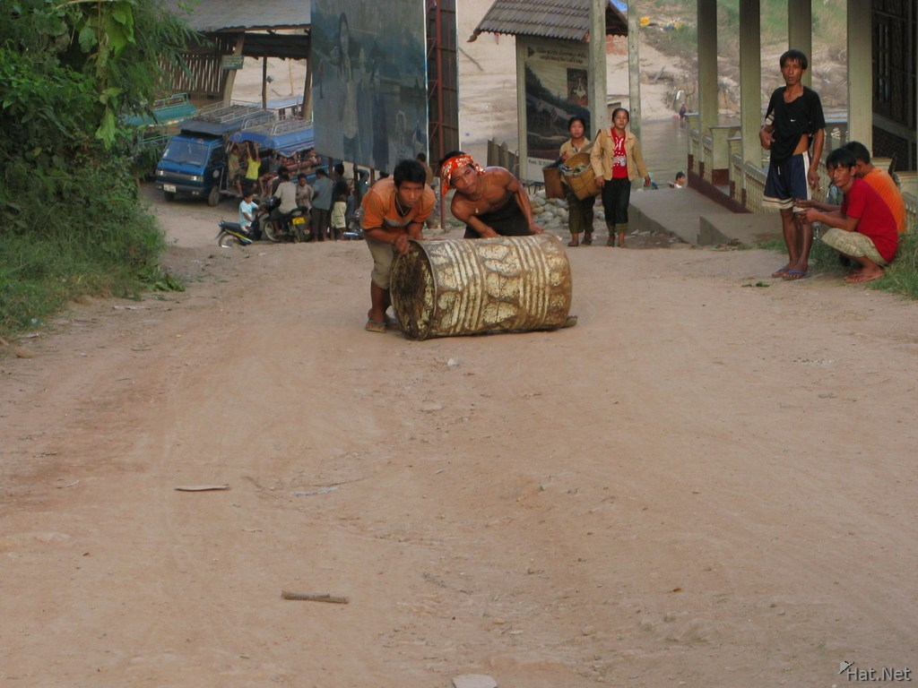 laos labour rolling up gas tank