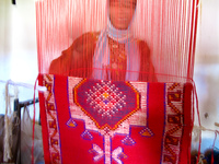 peace corp woman carpet cooperative Dades Valley, Morocco, Africa