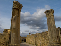 view--volubilis roman columns under cloudy sky Meknes, Moulay Idriss, Imperial City, Morocco, Africa