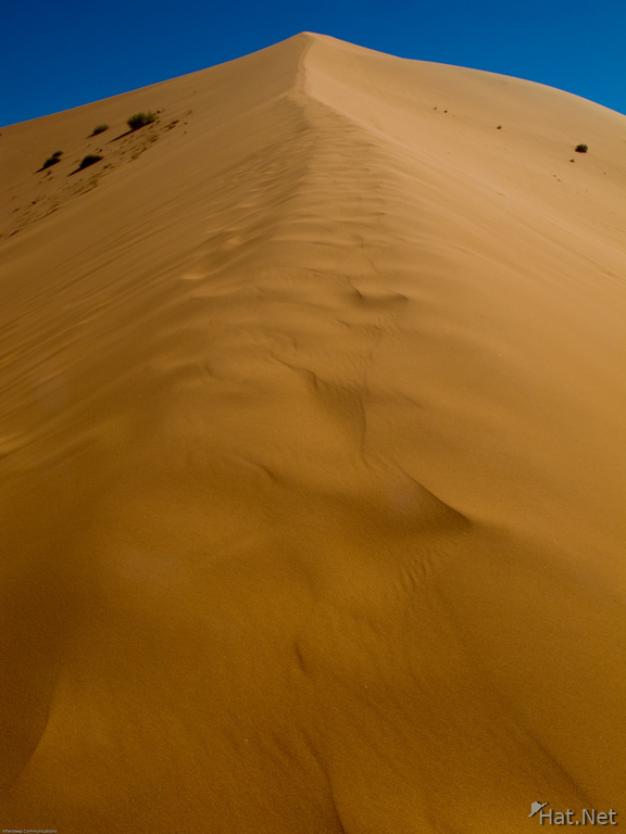 uphill to highest sand dune